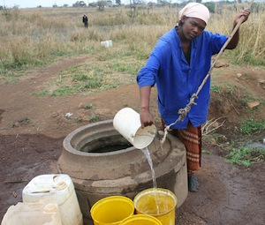 Getting water is a daily chore for this woman in Swaziland.  / Mantoe Phakathi/IPS