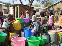 People Collecting Water at One of Kiosks / Charles Mpaka