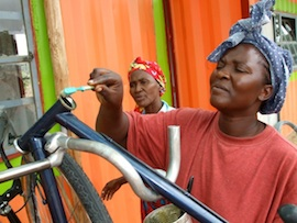 Repairing bicycles in Rundu, Namibia. / Gail Jennings/IPS