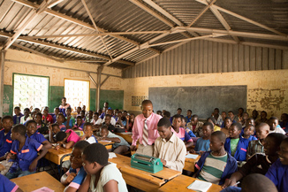 Children gather at a school in Malawi. Credit: Peter Caton/ Sightsavers