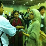 In Rio de Janeiro, Brazil, journalist Zofeen Ebrahim (right) interviews a source at the UN summit on sustainable development.