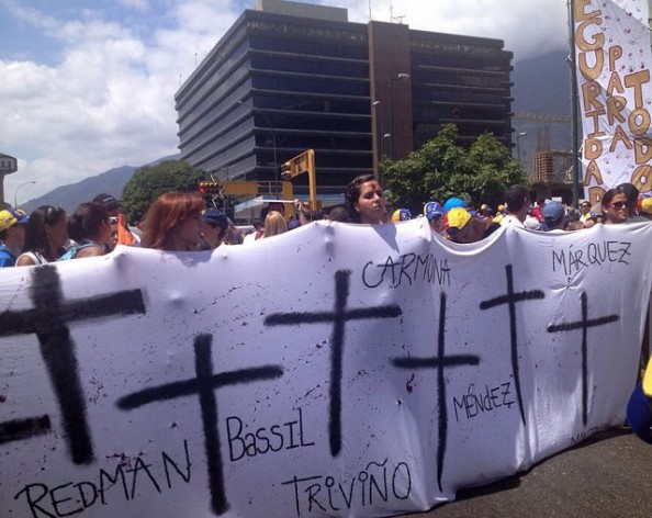 Students and relatives of protesters recently killed in Venezuela march in Caracas on Feb. 22. Credit: Estrella Gutiérrez/IPS