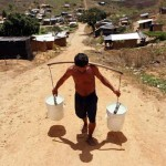 A man hauls water at the Chico Mendes landless peasant camp in Pernambuco, Brazil. Credit: Alejandro Arigón/IPS