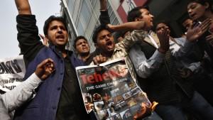 Activists of the Akhil Bharatiya Vidyarthi Parishad (ABVP), linked to India's main opposition Bharatiya Janata Party (BJP), shout slogans during a protest against Tarun Tejpal, editor-in-chief of India's leading investigative magazine, Tehelka, in New Delhi, Nov. 22, 2013. Credit: Adnan Abidi/Reuters